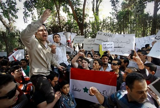 Around one hundred Syrians living in Egypt demonstrate against the recent actions of the Syrian government and in support of protesters, outside the Syrian embassy in Cairo, Egypt Sunday, March 27, 2011. (AP Photo)