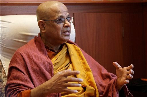 In this photo taken Tuesday, March 22, 2011, the Venerable Bogoda Seelawimala, head priest at London's Buddhist Vihara temple, speaks to The Associated Press in London. (AP Photo/Sang Tan)
