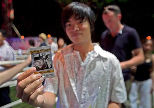 """A Vietnamese student shows his checked ticket before entering the venue of the concert named """"Bob Dylan - Live in Vietnam,"""" a one night only show held at RMIT University in Ho Chi Minh City, Vietnam on Sunday, April 10, 2011."""