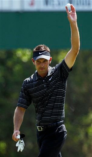 Charl Schwartzel of South Africa holds up his ball after an eagle on the third hole during the final round of the Masters golf tournament Sunday, April 10, 2011, in Augusta, Ga.