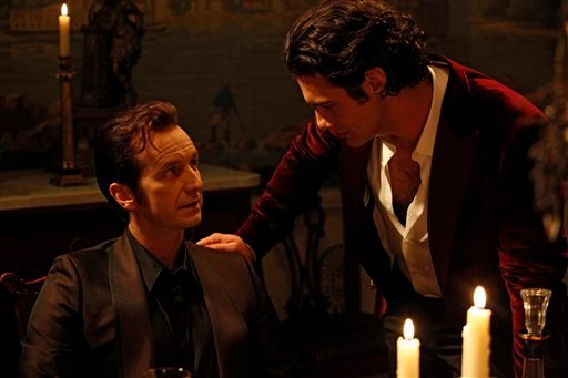 "In this undated publicity image released by HBO, Denis O'Hare, left, and Theo Alexander are shown in a scene from ""True Blood."" The HBO drama series ""True Blood"" is among this year's recipients of media awards from the Gay and Lesbian Alliance."