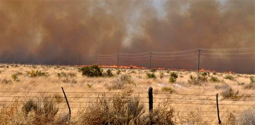 An uncontrolled wildfire burns at the Jeff Davis and Presidio County line near Fort Davis, Texas April 10, 2011. A fast-moving wildfire had spread to more than 60,000 acres in Presidio County and Jeff Davis County. (AP Photo/Billy Marginot)