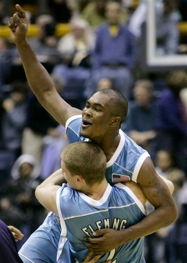 This Dec, 9, 2006 file photo shows San Diego basketball player Brandon Johnson, top, celebrating a win in Berkeley, Calif.