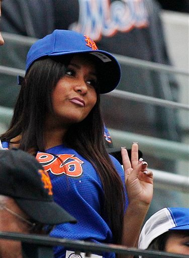 Nicole 'Snooki' Polizzi poses for a photograph by a fan during the fifth inning of a baseball game between the Washington Nationals and the New York Mets, Friday, April 8, 2011, at CitiField in New York. (AP Photo/Frank Franklin II)