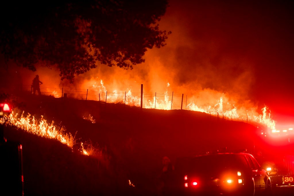 Flames from a backfire burn as CalFire crews battle a wildfire near Mariposa, Calif., Tuesday (AP Photo/Noah Berger)