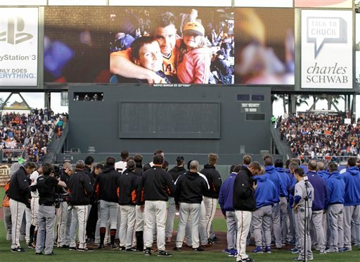 The San Francisco Giants and Los Angeles Dodgers stand for a moment of silence for paramedic Bryan Stow, pictured above, who was beaten at Dodger Stadium earlier this month, before their baseball game in San Francisco, Monday, April, 11, 2011.