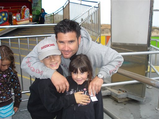 This undated image provided Tuesday April 5, 2011 by John Stow shows Bryan Stow holding his 12-year-old son and 8-year-old daughter.