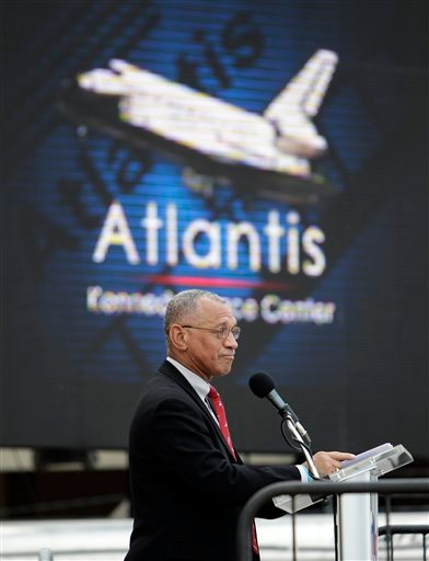 NASA Administrator Charles Bolden, in front of a large television monitor, announces that space shuttle Atlantis will make it's final destination at the Kennedy Space Center in Cape Canaveral, Fla., Tuesday, April 12, 2011.