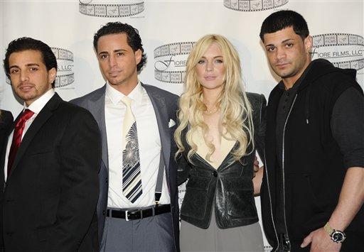 From left, Carmine Gotti Agnello, John Gotti Agnello, Lindsay Lohan and Frank Gotti Agnello attend a press conference for the film 'Gotti: Three Generations' at The Sheraton Hotel on Tuesday, April 12, 2011 in New York.