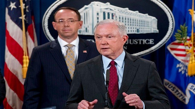 Attorney General Jeff Sessions accompanied by Deputy Attorney General Rod Rosenstein, left.