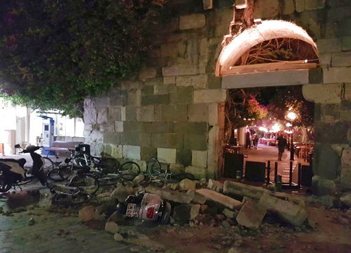 A powerful earthquake struck Greek islands and Turkey's Aegean coast early Friday morning, damaging buildings and a port and killing at least two people, authorities said. (Kostoday.gr via AP)
