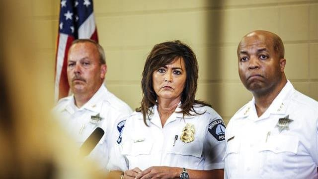 Minneapolis police chief Janee Harteau, center, stands with police inspector Michael Kjos, left, and assistant chief Medaria Arradondo during a news conference Thursday, July 20, 2017, Minneapolis.