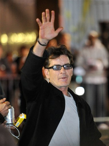 FILE - In this April 3, 2011 file photo, actor Charlie Sheen waves to fans as he leaves the Chicago Theatre in Chicago.