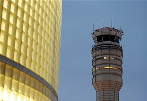 The FAA control tower at Reagan National Airport is seen in Arlington, Wednesday, March 23, 2011. (AP Photo/Cliff Owen)