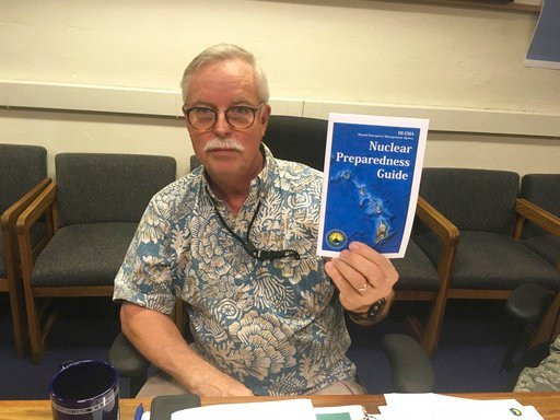 Toby Clairmont, the Hawaii Emergency Management Agency's executive officer, shows new informational materials to a reporter in Honolulu on Friday, July 21, 2017.
