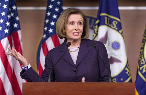 House Minority Leader Nancy Pelosi of Calif. gestures during a news conference on Capitol Hill in Washington Thursday, April 14, 2011. (AP Photo/Evan Vucci)