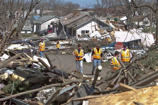 Volunteers from a nearby school help cleanup tornado damage, in Mapleton, Iowa, Monday, April 11, 2011. (AP Photo/Nati Harnik)
