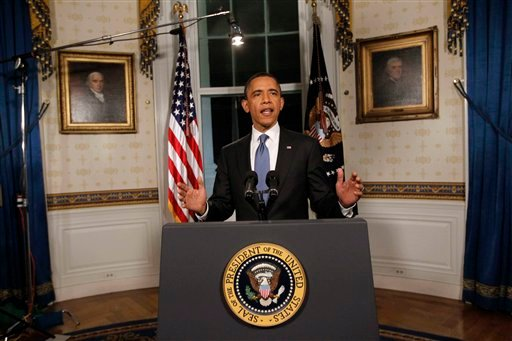 April 8, 2011 photo: President Obama poses for photographers in the Blue Room at the White House after he spoke regarding the budget and averted government shutdown after a deal was made. (AP Photo/Charles Dharapak)