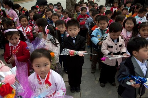 North Korean children arrive at a monument of Kim Il Sung to pay their respects at Mansu Hill in Pyongyang, North Korea.
