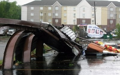 A billboard lays collapsed on the ground after a tornado went through Friday, April 15, 2011 in Tuscaloosa, Ala..