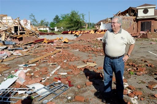 The Rev. Mike Johnson stands in the remains of Boone's Chapel Baptist Church on Saturday, April 16, 2011 in Boone's Chapel, Ala., in Autauga County after severe winds hit late Friday night. (AP Photo/Montgomery Advertiser, Amanda Sowards)