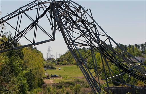The tornado knocked down these large electric transmission towers on Valley Stream Dr. in Raleigh, N.C. on April, 2011. (AP Photo/News & Observer, Chris Seward)