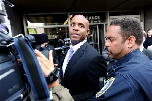 Former baseball player Barry Bonds, center, leaves federal court on Wednesday, April 13, 2011, in San Francisco, after being convicted of obstruction of justice.