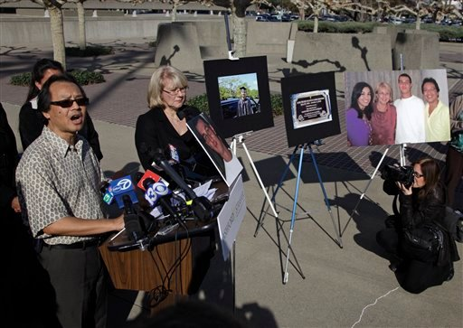 Fred Santos, left, and his wife Kathy, parents of Luis Santos who was stabbed to death just over two years ago, hold a news conference outside the Sacramento County Courthouse in Sacramento, Thursday, Jan. 20, 2011.