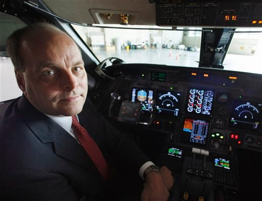 Sept. 18, 2008 file photo, Federal Aviation Administration (FAA) Chief Operating Officer Hank Krakowski poses in the cockpit of an FAA jet in a hangar at Washington's Reagan National Airport. (AP Photo/Charles Dharapak, File)