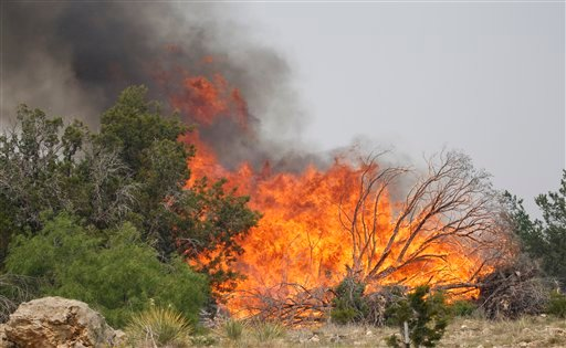 A wildfire flairs up on the west side of Possum Kingdom Lake, Texas, Saturday, April 16, 2011. (AP Photo/LM Otero)