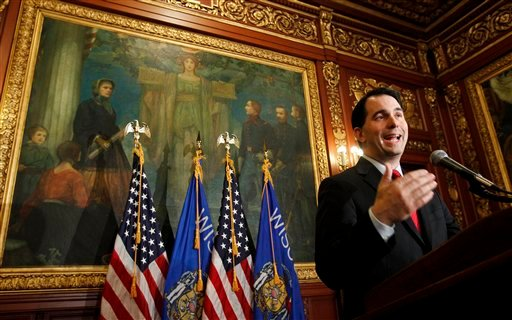 In this Feb. 17, 2011, file photo Republican Wisconsin Gov. Scott Walker talks to the media at the State Capitol in Madison, Wis.  (AP Photo/Andy Manis, File)