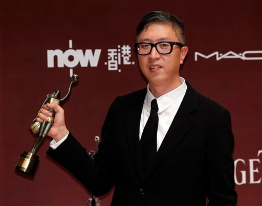 "Hong Kong director Felix Chong Man Keung displays his trophy after winning the Best New Director award for the movie ""Once A Gangster"" at the 30th Hong Kong Film Awards in Hong Kong Sunday, April 17, 2011. (AP Photo/Kin Cheung)"