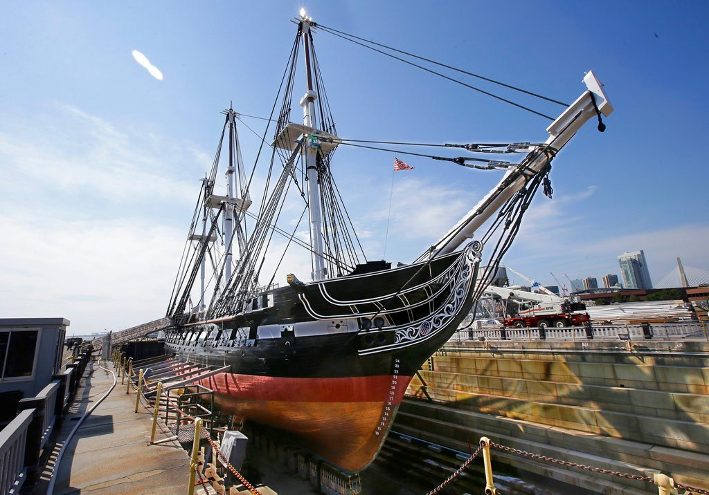 """In this Monday, July 17, 2017 photo the USS Constitution, """"Old Ironsides,"""" the world's oldest commissioned warship still afloat, sits in dry dock in Boston after a more then two year long restoration. (AP Photo/Stephan Savoia)"""