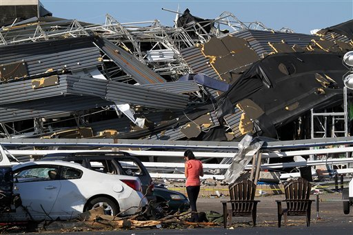 Annina Purdy, who was inside the Lowe's hardware store in Sanford, N.C. the previous day when a tornado destroyed the building, returned to the store's parking lot on April 17, 2011, to reclaim personal belongings. (AP Photo/Ted Richardson)