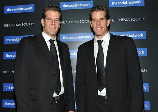 FILE - In this Sept. 29, 2010 file photo, twins Cameron Winklevoss and Tyler Winklevoss attend a special screening of 'The Social Network' in New York. On Monday, April 11, 2010