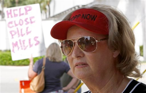 In this April 15, 2011 photo, Renee Doyle talks to a reporter during a protest in front of a pain clinic in Fort Lauderdale, Fla. Doyle. (AP Photo/Alan Diaz)