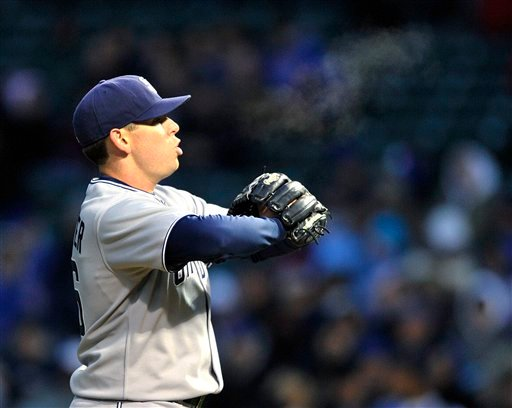San Diego Padres pitcher Tim Stauffer exhales while pitching against the Chicago Cubs during the first inning of a baseball game on a cool night, Monday, April 18, 2011, in Chicago. (AP Photo/Jim Prisching)