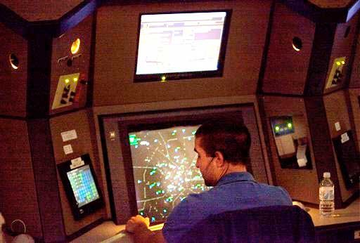 An air traffic controller works in a terminal radar approach control room Monday, April 18, 2011 at the Atlanta TRACON in Peachtree City, Ga.
