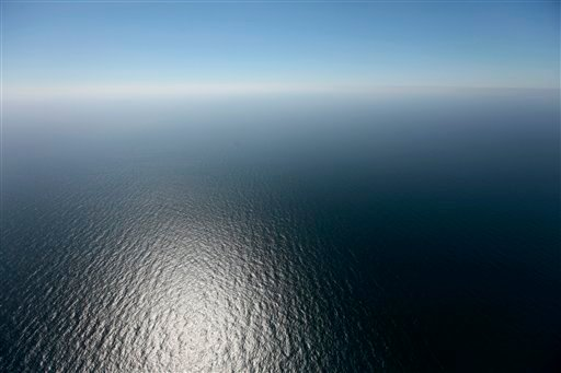 In this April 10, 2011 aerial photo, empty, open water is seen at the site of the Deepwater Horizon oil rig explosion and oil spill, almost one year later, in the Gulf of Mexico, 50 miles off the cost of Louisiana.