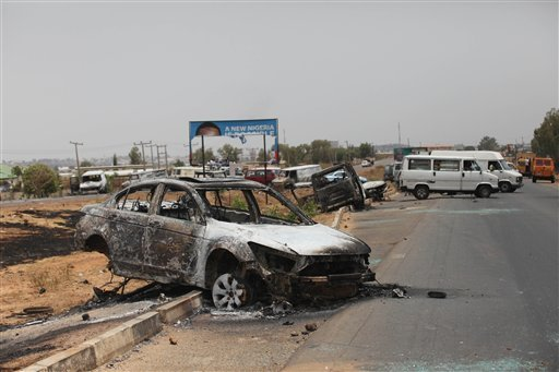 A burnt out car on a street in Kaduna, Nigeria, Tuesday, April 19, 2011.