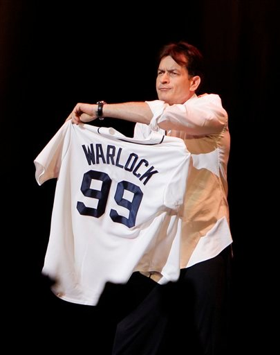 Actor Charlie Sheen shows off his Detroit Tigers jersey during his performance at the Fox Theatre in Detroit, Saturday, April 2, 2011.