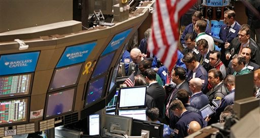 In this April 19, 2011 photo, traders work on the floor of the New York Stock Exchange in New York.
