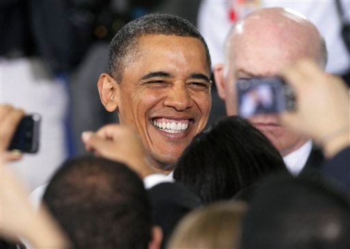 President Barack Obama greets members of the audience during town hall meeting at North Virginia Community College in Annandale, Va., Tuesday, April 19, 2011.