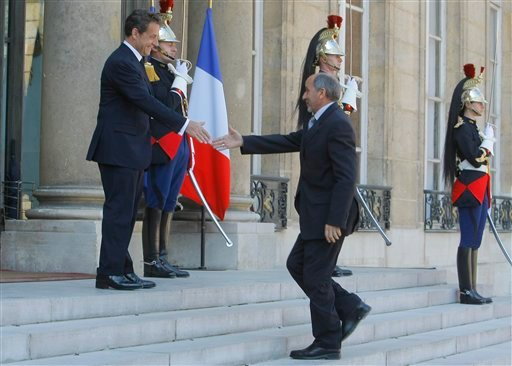 France's President Nicolas Sarkozy, left, welcomes Libyan National Transitional Council's Mustapha Abdeljalil at the Elysee Palace in Paris, France, Wednesday, April 20, 2011.