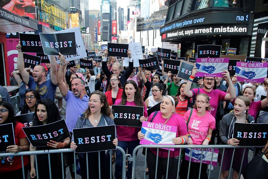 Protestors gather in Times Square, Wednesday, July 26, 2017, in New York. (AP Photo/Frank Franklin II)