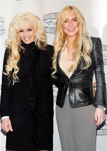 """Victoria Gotti, daughter of John Gotti Sr., left, and actress Lindsay Lohan pose during a news conference for the film """"Gotti: Three Generations"""", based on the life of John Gotti, leader of the Gambino crime family, at The Sheraton Hotel on Tuesday."""