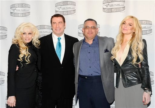 """FILE - In this April 12, 2011 file photo, Victoria Gotti, author and daughter of the late John Gotti, left, actor John Travolta, John Gotti Jr. and actress Lindsay Lohan pose during a news conference for the film """"Gotti: Three Generations"""""""
