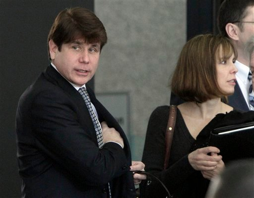 Former Illinois Gov. Rod Blagojevich arrives at Federal Courthouse with his wife Patti April 21, 2011 in Chicago. Jury selection began April 20. (AP Photo/M. Spencer Green)