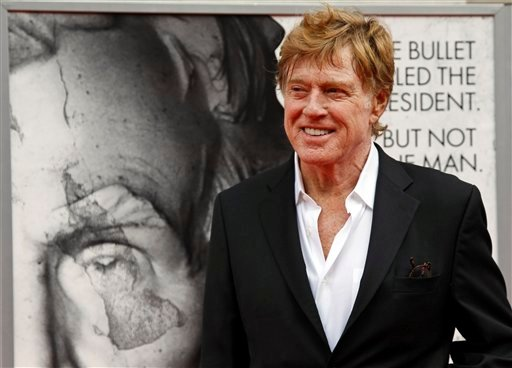 "In this April 10, 2011 file photo, director Robert Redford arrives at Ford's Theatre for The American Film Company's premiere of his film ""The Conspirator"" in Washington. (AP Photo/Alex Brandon, File)"