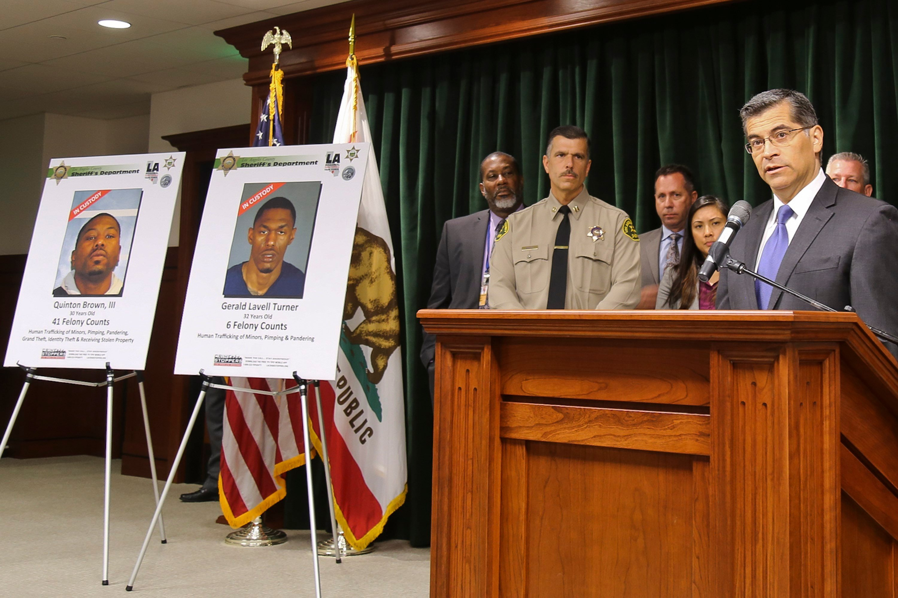 California Attorney General Xavier Becerra, far right, announces what authorities believe to be one of the largest human trafficking cases in the western United States during a news conference in Los Angeles (AP Photo/Michael Balsamo)
